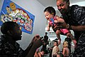 US Navy 111025-N-WW409-286 Sailors assigned to the guided-missile destroyer USS Mustin (DDG 89), play with children at the Pattaya Orphanage.jpg