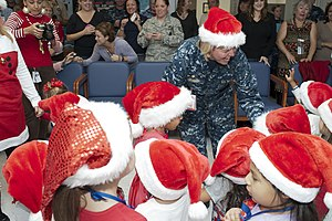 US Navy 111209-N-KF478-081 Capt. Gina M. Jaeger, commanding officer of Naval Health Clinic Corpus Christi, praises preschoolers from the Naval Air.jpg