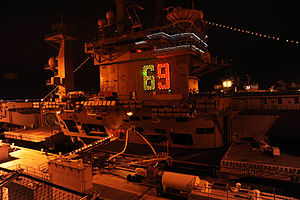 US Navy 111216-N-RY232-023 USS Dwight D. Eisenhower (CVN 69) displays holiday lights during Operation Decorum, an annual light show sponsored by Na.jpg