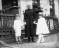 Unidentified woman with two children.png
