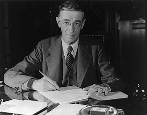 Vannevar Bush seated at a desk, sometime between 1940 and 1944.