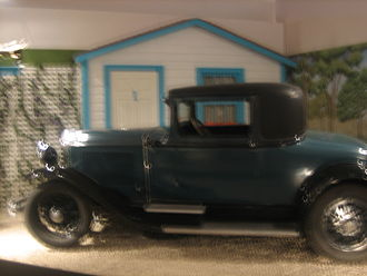 Panhandle–Plains Historical Museum - A 1920s vehicle is parked outside a motel at the Panhandle-Plains Museum.