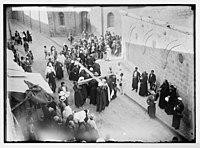 Via Dolorosa, beginning at St. Stephen's Gate. Pilgrims carrying cross on Via Dolorosa. LOC matpc.05443.jpg