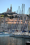 View of the Basilique Notre Dame de la Garde (the Mariners church) as seen from The Old Port of Marseille, Provence-Alpes-Côte d'Azur, Southeastern France , Western Europe