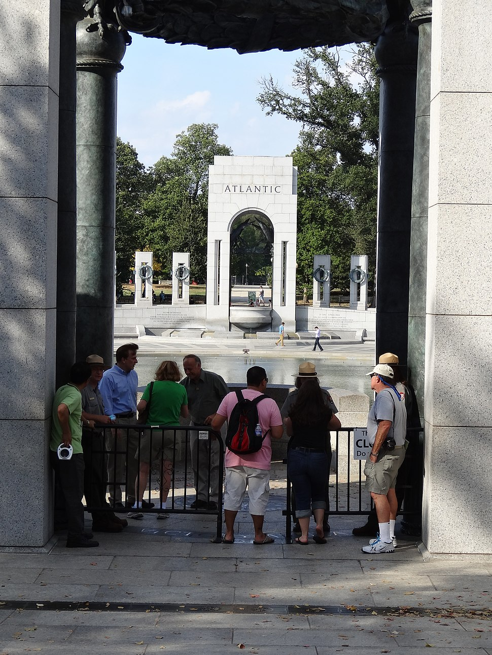 Visitors entering World War II Memorial; south entrance; Washington, DC; 2013-10-06
