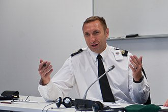 Warrant Officer of the Naval Service - Image: WO1 Terry Case speaks during a NATO NCO strategy session