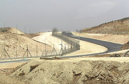 Israeli West Bank barrier separating Israel and the West Bank West Bank Fence South Hebron.JPG