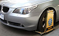 Wheel clamped BMW5Series, Little Collins St, Melb, 19.10.2011, jjron crop.jpg