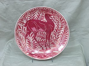John Pearson (artist) - William De Morgan Antelope Charger in red lustre decorated by John Pearson