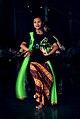 Woman with green scarf dancing.jpg