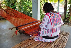 Amuzgo textiles - Amuzgo woman weaving a rebozo on a backstrap loom