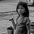 Young Street Peddler (close-up) (12462911343).jpg