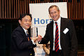 Zhang Yue, Chairman, Broad Air, awarded by Didier Mouget, Managing Partner, PwC - Flickr - Horasis.jpg
