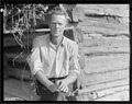 """Esco Glandon, a renter at Bridges Chapel near Loyston, Tennessee. He rebuilt the cabin in which his family lives.... - NARA - 532688.tif"