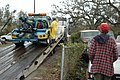 (Hurricane Katrina) Pass Christian, Miss., January 17, 2006 -- Wrecker driver Johnny Hogan looks on as a used wrecker donated by the California Tow Truck Driver's Association is del - DPLA - c2fbea03f23acde3e6695cca63f05332.jpg