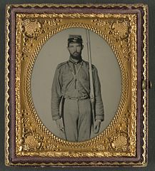 (Unidentified soldier in Confederate uniform and Craig's Rifles, or 28th Virginia Infantry Regiment, kepi with musket) (LOC) (14542520576).jpg