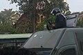 05 Police man with a shotgun - Flickr - Al Jazeera English.jpg