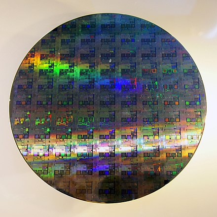 A 12-inch silicon wafer can carry hundreds or thousands of integrated circuit dice 12-inch silicon wafer.jpg