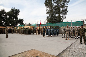 Nangarhar Province - U.S. and Afghan National Security Forces (ANSF) stand in formation during a transfer of authority ceremony on Forward Operating Base Fenty in December 2012.