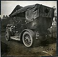 1906 Pope Toledo automobile seen from the back, coated in mud.jpg