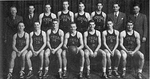 1943–44 Michigan Wolverines men's basketball team - 1943–44 team portrait Back row (l to r): mngr. Hugh Miller, Rex Wells, Rill Seymour, Wayne Thompson, Bob Wiese, head coach Bennie Oosterbaan, asst. coach William Barclay Front Row: Charles Kelterer, Thomas King, Elroy Hirsch, Dave Strack, John Leddy, Richard Shrider, Don Lund