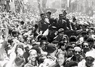 Egyptian revolution of 1952 - Members of the Free Officers welcomed by crowds in Cairo in January 1953. Standing in the automobile, from left to right: Youssef Seddik, Salah Salem, Gamal Abdel Nasser and Abdel Latif Boghdadi