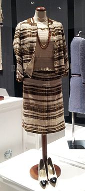f3b4c35c37bd Chanel suit and silk blouse with two-tone pumps