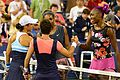 1st round US Open 2013 doubles (9634011064).jpg