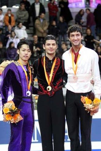 2007–08 Grand Prix of Figure Skating Final - The men's podium. From left: Daisuke Takahashi (2nd), Stéphane Lambiel (1st), Evan Lysacek (3rd).