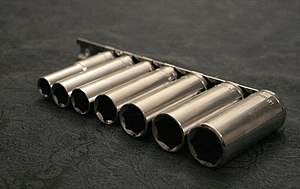Socket wrench - A set of deep sockets on a rail.