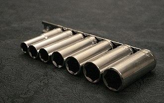 Socket wrench - A set of deep sockets on a rail.