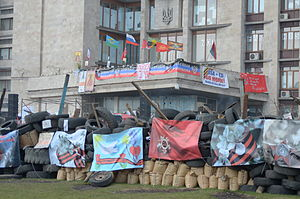 War in Donbass - The barricade outside the Donetsk RSA, with banners displaying anti-western slogans