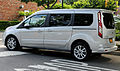 2014 Ford Transit Connect Wagon Titanium LWB left rear.jpg