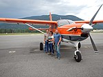 2016. L-R Roy Mask (Region 2), Amanda Grady (New Mexico, Region 3) and Chad Nelson (Region 4) with Kodiak. Western States fly-in. Sandpoint, Idaho. (35761897753).jpg