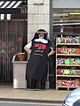 2018-05-17 Butcher dressed as a-Nun, Icarus Hines butchers shop, Church Street, Cromer.JPG