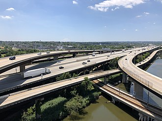View south along I-95 from the ramp from I-395 to I-95 northbound in Baltimore 2019-07-15 13 34 07 View south along Interstate 395 (Cal Ripken Way) at its junction with Interstate 95 from the overpass for the ramp from Interstate 395 southbound to Interstate 95 northbound in Baltimore City, Maryland.jpg