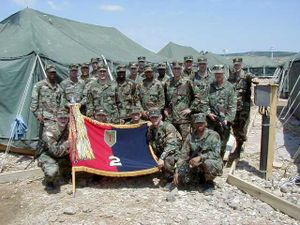 2nd Brigade Combat Team, 1st Infantry Division - Members of the 2nd Brigade pose with their brigade colors after they were unfurled in Kosovo in 1999.