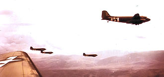 99th Airlift Squadron - 99th Troop Carrier squadron C-47s in formation during Operation Varsity, March 1945