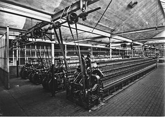 Line shaft - Four wool spinning machines driven by belts from an overhead lineshaft (Leipzig, Germany, circa 1925)