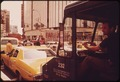 A FRUSTRATED DRIVER SITS THROUGH A TRAFFIC JAM IN HERALD SQUARE - NARA - 548272.tif