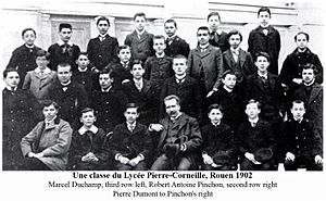 Lycée Pierre-Corneille - A class at the Lycée Pierre-Corneille, 1902. Artists Robert Antoine Pinchon (second row, right) and Marcel Duchamp (third row, left, out of focus). On Pinchon's right is very likely Pierre Dumont