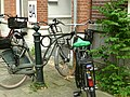 A close-up photo of parked bicycles in the Plantage Parklaan in Amsterdam city; high resolution image by FotoDutch in June 2013..jpg