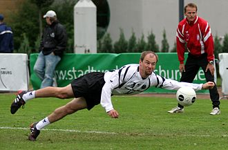 Fistball - A fistballer defends the ball at full stretch