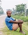 A man sitting on the back of Road during lockdown-Shambhunath Municipality , Nepal-4556.jpg