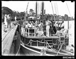A sailing vessel with people on board, berthed near Maryborough Rowing Club (7688336516).jpg