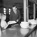 A teacher hands plates of rice pudding to one of the London evacuees attending Marchant's Hill School, Hindhead, Surrey, 1944. D21633.jpg