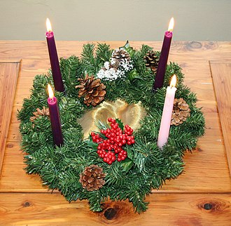 Gaudete Sunday - An Advent Wreath with the customary single candle in rose for Gaudete Sunday