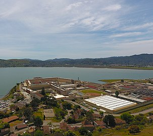 Aerial view of San Quentin, including the housing units, yard, education center, and Prison Industry Authority facilities