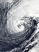 A non-tropical cyclone with clouds wrapping cyclonically around an open center