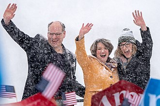 Amy Klobuchar - Klobuchar (center) with her husband and daughter at her campaign announcement